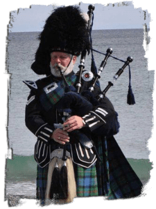 photo of bag piper playing pipes