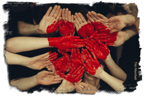 image of hands with heart painted across hands