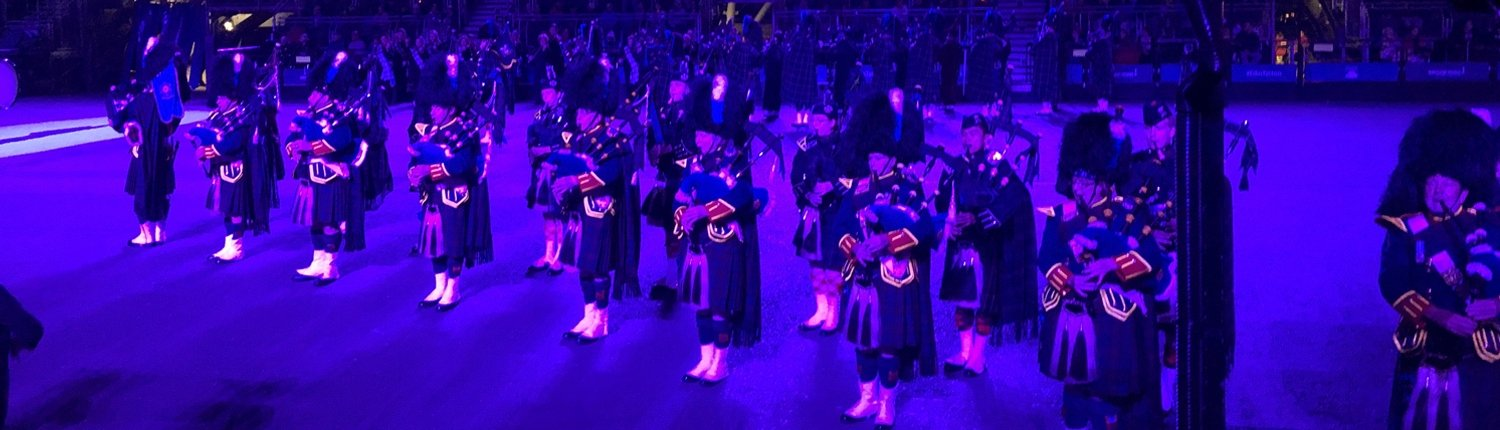 image of Scottish bagpipers performing at a military tattoo